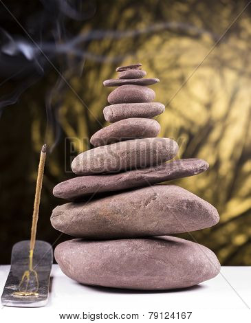 Balanced Stone Tower With Smoke