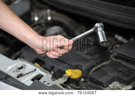 Auto Mechanic With Chrome Plated Wrench In Closeup