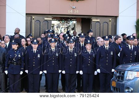 NYPD officers in front of chapel