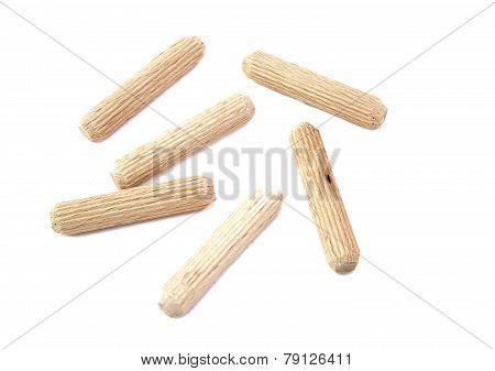 Close up of six wood dowels