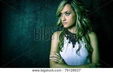 Fashion young girl with white dress and black necklace