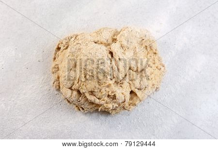 Rough Ball Of Bread Dough On A Floured Work Surface