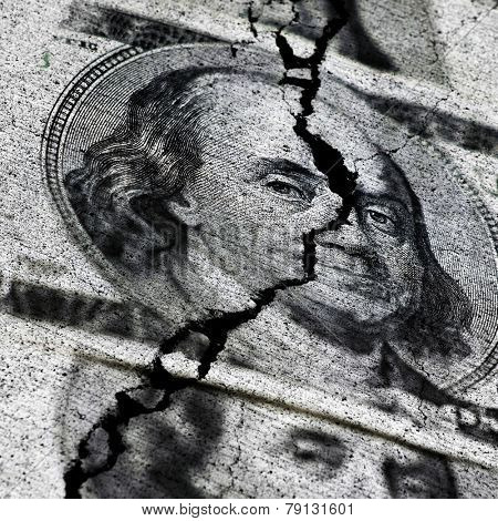 Several American Dollars ripped or torn in half symbolizing the destruction of the economy