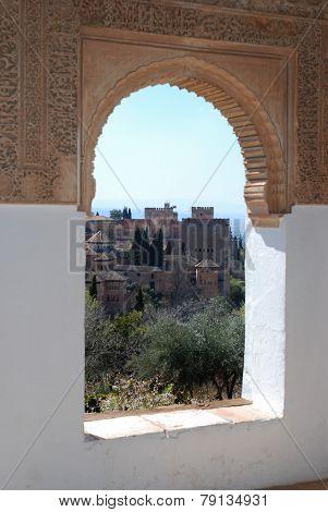 Castle seen through Moorish window, Granada.