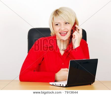 business woman with phone and laptop