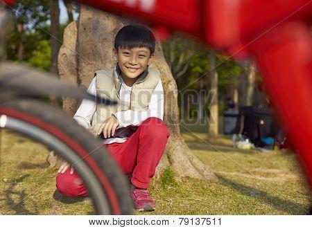 Boy Rest After Riding Bike