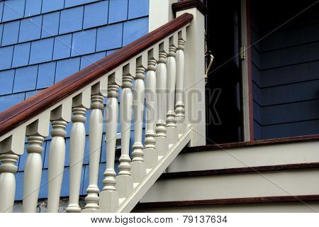 Staircase and railing leading to home's front door