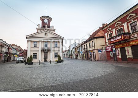 Historic Town Hall In The City Center Of Small Polish Town Called Konin