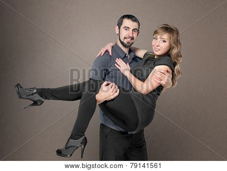Young Men Holding Woman In Arms