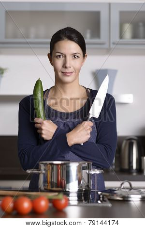 Happy Young Woman Posing In Her Kitchen
