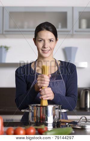 Happy Young Cook Preparing Italian Spaghetti