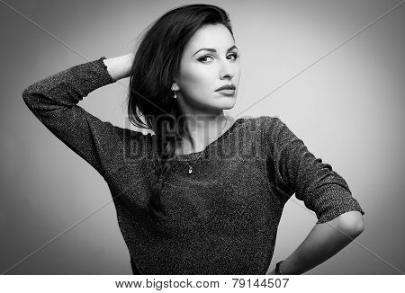 beautiful model looking at camera touching hair b&w