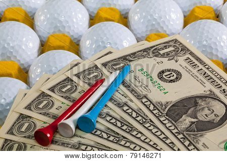 White Golf Balls In The Yellow Box And Us Money