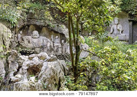 Maitreya And Disciples Carving In Feilai Feng Caves, China