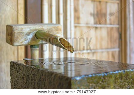 Bamboo Fountain In Nomura-ke Samurai House in Kanazawa, Japan