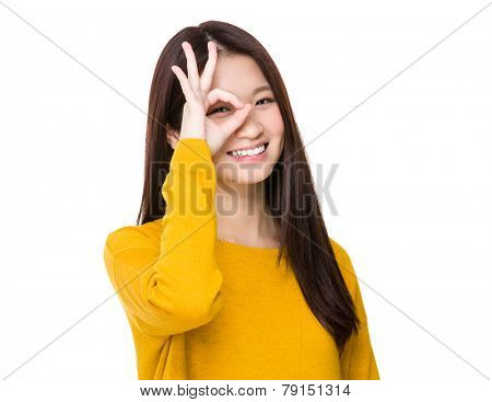 Woman with ok sign ok eye