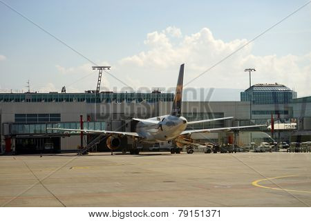 GENEVA - SEP 16: docked jet airplanes on September 16, 2014 in Geneva, Switzerland. Geneva International Airport is the international airport of Geneva, Switzerland.