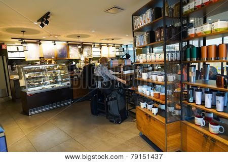 GENEVA - SEP 11: Starbucks cafe interior at train station on September 11, 2014 in Geneva, Switzerland. Starbucks is the largest coffeehouse company in the world, with more then 23000 stores