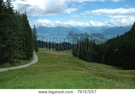 Lake, Mountains And Ski Lift Nearby Luzern In Switzerland
