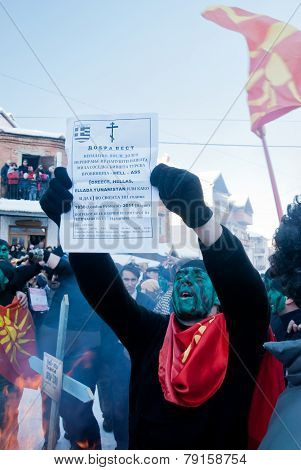 VEVCANI, MACEDONIA - JANUARY 13, 2012: A man dressed up as a Macedonian soldier reads an obituary at Vevcani Carnival, southwestern Macedonia