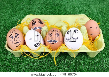 Eggs in egg tray on green background