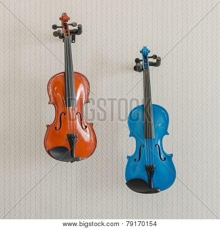 Blue And Brown Violins Hang On Wall