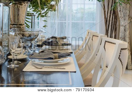 Luxury Dinning Room With Table Set On Wooden Table At Home