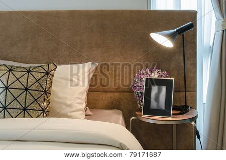 Single Bed With Lamp On Table In Bedroom