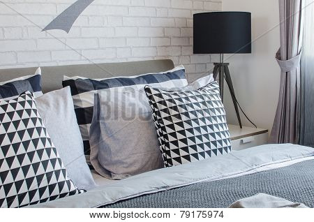 Modern Bedroom With Black And White Pillows And Black Lamp