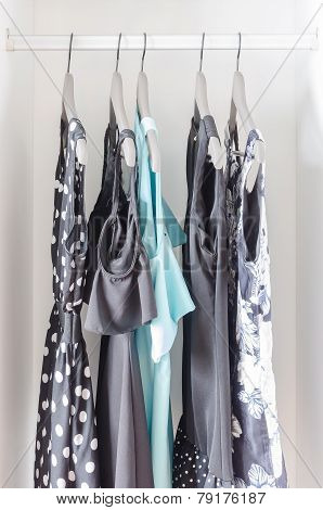 Row Of Dress Hanging On Coat Hanger In Wardrobe