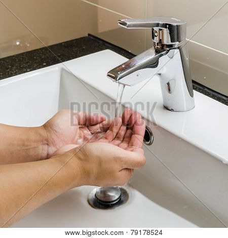 Washbasin And Faucet With Hand Washing At Home