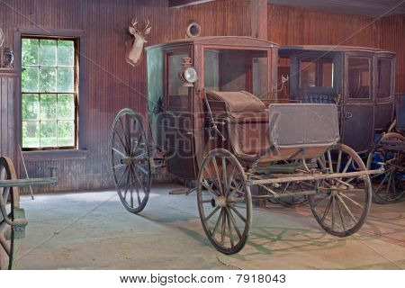 Antique Horse-drawn Carriages Stored In A Barn