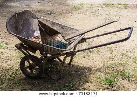 Old Wheelbarrow With Dustpan