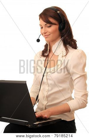 Beautiful girl with a notebook in headsets.
