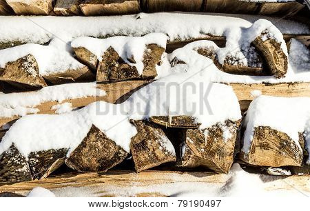 Pile Of Chopped Wood Stacked In  Winter
