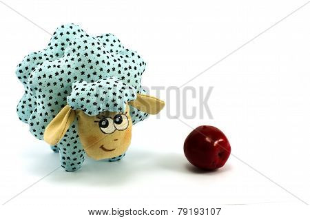 Rag-doll turquoise lamb with red apple