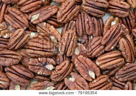 A Group Of Pecan Halves On Wooden Flat