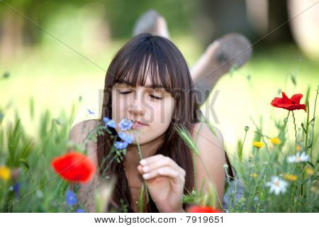 Teen Smelling Flower