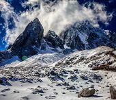 stock photo of jade  - The Jade Dragon Snow Mountain rises high into the air. Tourists use oxygen to walk up the pathway as it rises to 4680 meters above sea level.
