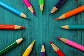 stock photo of pencils  - Colorful pencils on color wooden background - JPG