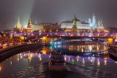 picture of winter palace  - Moscow Kremlin at vague winter night. Moscow-river and tourist pleasure boat. View from bridge.