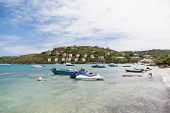 foto of ski boat  - Small boats and jet skis anchored bya tropical luxury resort - JPG