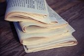 stock photo of newspaper  - Newspapers on old wood background - JPG