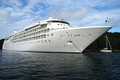 picture of cruise ship caribbean  - Luxury Cruise ship on the ancor next to island at sunny day - JPG