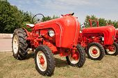 foto of tractor  - old red tractor restored on a meadow - JPG