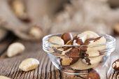 foto of brazil nut  - Some Brazil Nuts on vintage wooden background - JPG