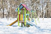 picture of playground school  - Snowy kids playground in the winter park - JPG