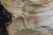 stock photo of aborigines  - Aboriginal tribal hand print using red ochre found on a rock in bushland Australia - JPG