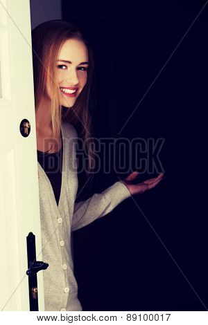 Young woman inviting us to her house