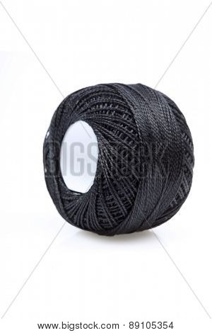 Ball of string on white background